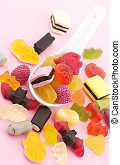 Colorful candy in spoon - Heap of colorful candy and white...