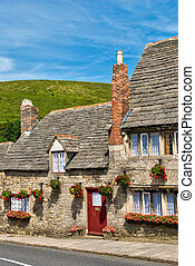 Row of limestone cottages in an English village - a row of...