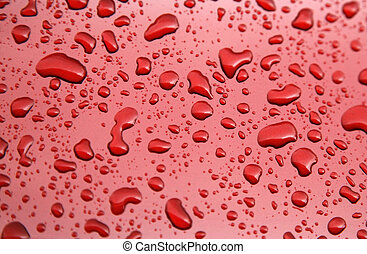 Water drops of rain on red background