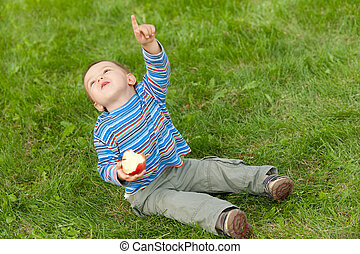Toddler showing the plain in the sky - A cheerful toddler...