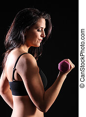 Strong beautiful girl bicep curl exercise in gym - Bicep...