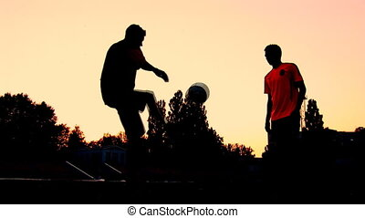 sunset 1 - soccer players train at sunset