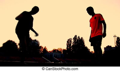 sunset 4 - soccer players train at sunset