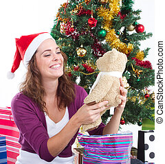 young woman open christmas gift