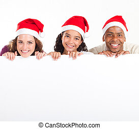 Christmas family behind whiteboard - happy Christmas family...
