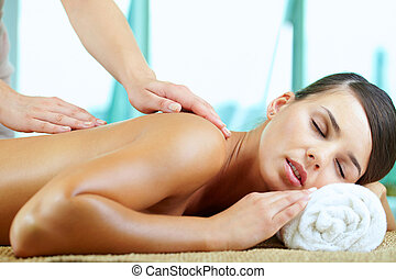 Pleasure  - A young woman having pleasure during massage