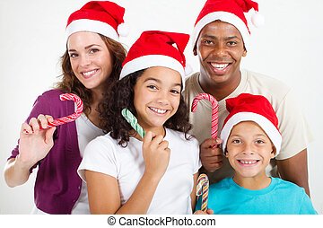 family with Christmas candy cane