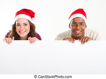 man and woman christmas banner - young man and woman holding...