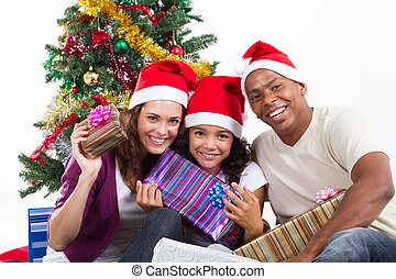 multiracial family with xmas gifts - happy multiracial...