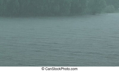 Downpour. - HD 1080 shot of summer downpour on a lake.
