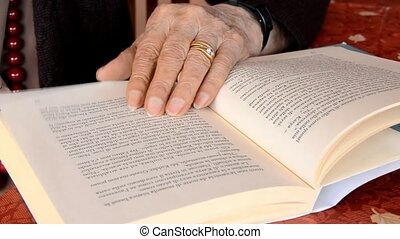reading - old woman reading a book