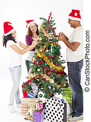family decorating Christmas tree - happy multiracial family...