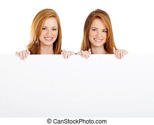 teen girls holding white board