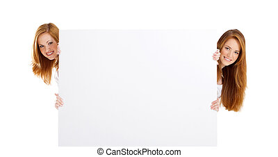 teen girls holding white board