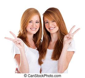 young teen girls - two beautiful young teen girl giving...