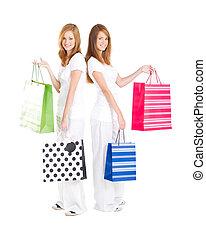 teen girls carrying shopping bag - beautiful teen girls...