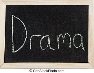 Board with DRAMA - A black board with a wooden frame and the...
