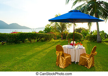 Candlelight dinner setting at outdoor