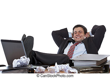 Young business man relaxes with feet at desk. Isolated on...