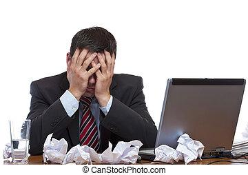 Frustrated man sitting desperate over paper work at desk....