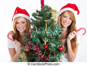 teen sisters holding candy cane