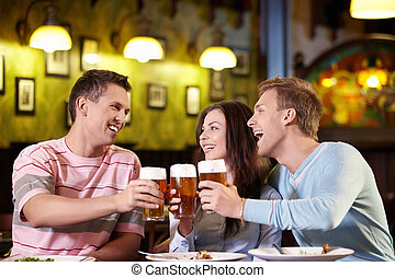 Beer - Young people with a beer in a restaurant