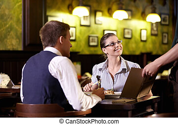 At restaurant - Young attractive couple in a restaurant