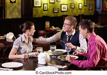 Dinner - Young people communicate during a dinner at a...