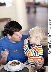 father and son having a breakfast