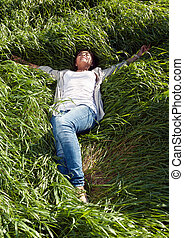 girl lying in the green grass - pin-up girl lying with her...