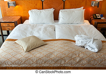 bed in a hotel room with bedside tables