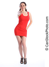 Thumbs up by smiling sexy woman in short red dress