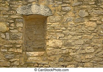 old stone wall witn a niche