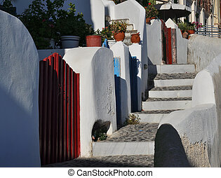Stairs and fances on an alley in Oia, Santorini, Greece