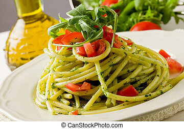 Pasta with arugula pesto and cherry tomatoes - photo of...