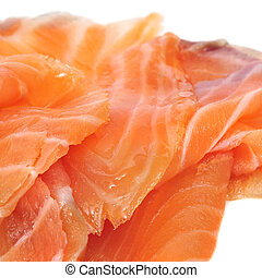 smoked salmon - closeup of some slices of smoked salmon on...