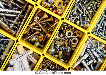 Screws, bolts and nuts - Detailed top view of a plastic work...