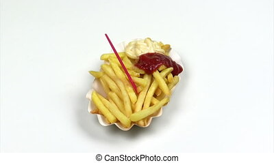 French fries with ketchup and mayonnaise rotating
