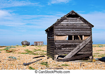 old shack - an abandoned shack on a shingle beach