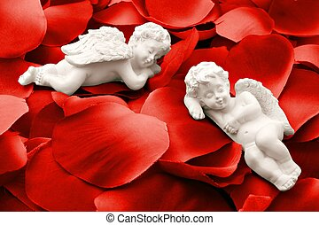 Two angels sleeping in rose petals - Two cute angels taking...