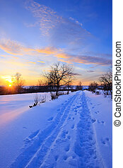 Sunset in countryside at winter, Russia