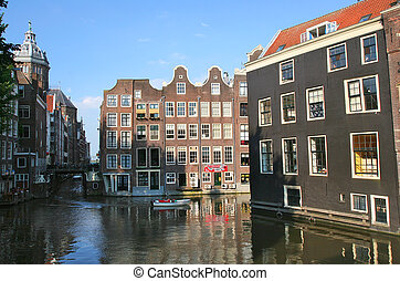 Amsterdam historic center. - View on canal and old houses in...