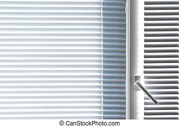 Window with white jalousie.