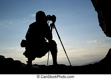 Silhouette of photographer in mountain. Element of design.