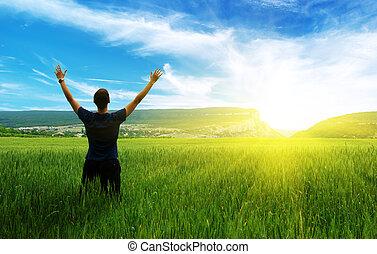 Man in green meadow. Emotional scene.