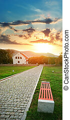 Way to sun - Road, bench, and house on the sunset Landscape...