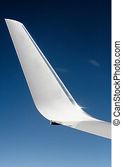 Aeroplane wing with sky background