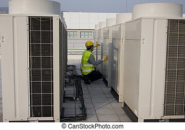 Technician - AC Tech Testing Voltage on the roof
