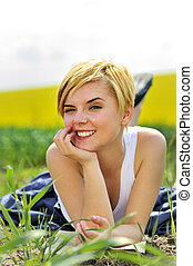 young blond woman give a wink