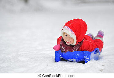 girl on sleigh